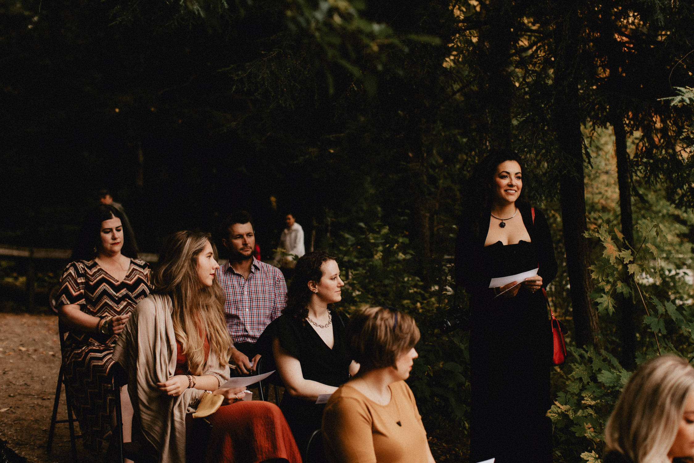 Guests read poetry during forest wedding ceremony - Huron Natural Area Micro Wedding Kitchener, Ontario