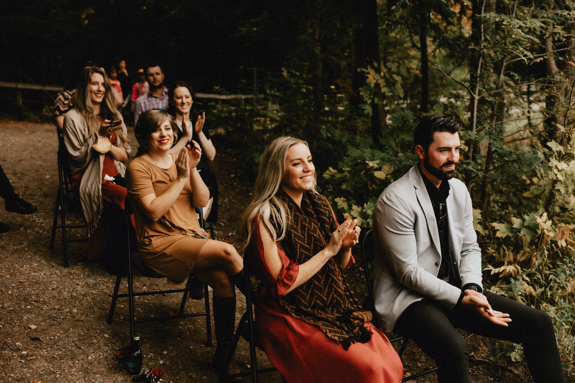 Wedding guests smile and clap - Huron Natural Area Micro Wedding Kitchener, Ontario